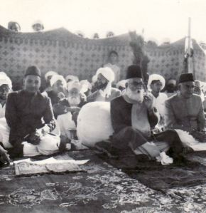 In this early 1970s picture Syed Muhammad Fazal Shah Sahib presides at an annual Majlis (urs of Hazrat Haider Ali Shah Sahib). On his right is his eldest son, Syed Barakat Ahmed and on his left is his younger brother, Nawab Sir Mehr Shah.